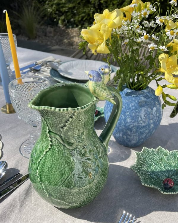 Green pitcher with birds
